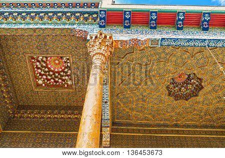 BUKHARA UZBEKISTAN - APRIL 29 2015: The picturesque floral patterns on the gilt background in Sheikh Nakshbund Mausoleum on April 29 in Bukhara.