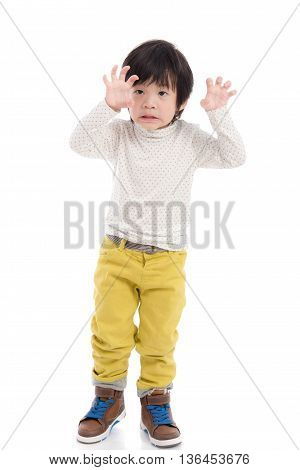 Cute asian boy reaching hands on white background isolated