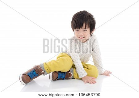Happy asian boy sitting on white background isolated