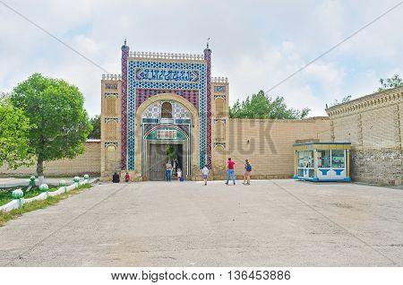 BUKHARA UZBEKISTAN - APRIL 29 2015: The beautiful brick gate of Sitorai Mokhi-Khosa Palace decorated with colorful glazed tiles on April 29 in Bukhara.