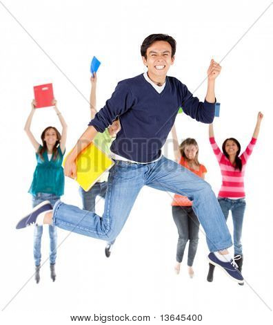 Happy group of students jumping - isolated over a white background