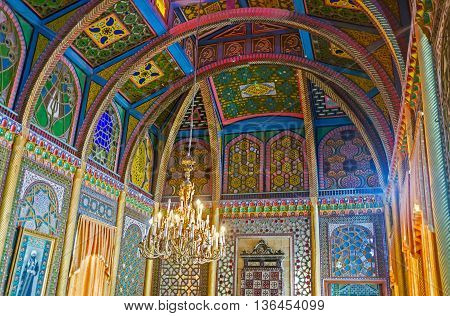 BUKHARA UZBEKISTAN - APRIL 29 2015: The dining room of Sitorai Mokhi-Khosa Palace boasts the special sliding walls stained glass ceiling and complex islamic patterns on April 29 in Bukhara.
