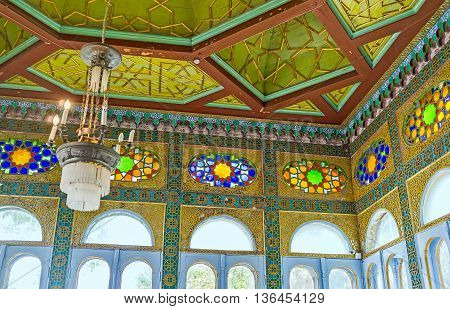BUKHARA UZBEKISTAN - APRIL 29 2015: The small chamber with large glass windows and carved wooden ceiling in Sitorai Mokhi-Khosa Palace on April 29 in Bukhara.