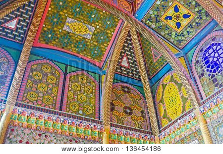 BUKHARA UZBEKISTAN - APRIL 29 2015: The stained glass screens on the ceiling in dining room of Sitorai Mokhi-Khosa Palace with unique colorful ornaments on April 29 in Bukhara.