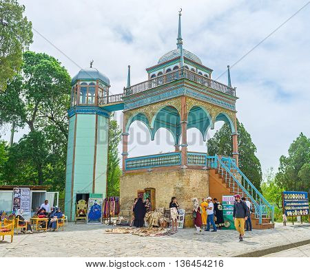 BUKHARA UZBEKISTAN - APRIL 29 2015: The Emir's pavilion of Sitorai Mokhi-Khosa Palace decorated with carved wooden details and colorful patterns on April 29 in Bukhara.