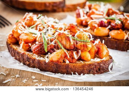 Baked Beans With Rosemary And Parmesan On Toast