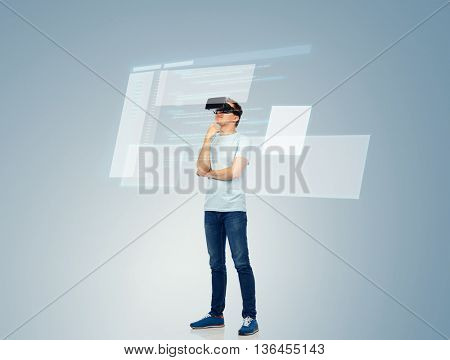 3d technology, virtual reality, entertainment, cyberspace and people concept - happy young man with virtual reality headset or 3d glasses thinking and looking at screen with coding