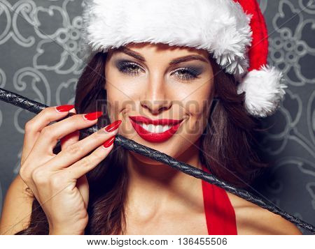 Sexy santa woman with whip portrait red lips bdsm