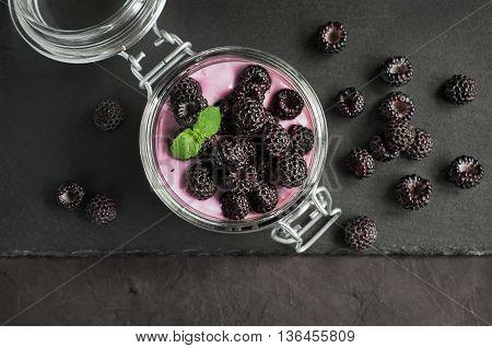Yogurt With Black Raspberry Or Blackberry In Glass Jar
