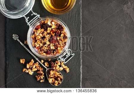 Granola With Nuts And Honey In Glass Jar