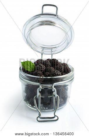 Black Raspberries Or Blackberries In A Glass Jar