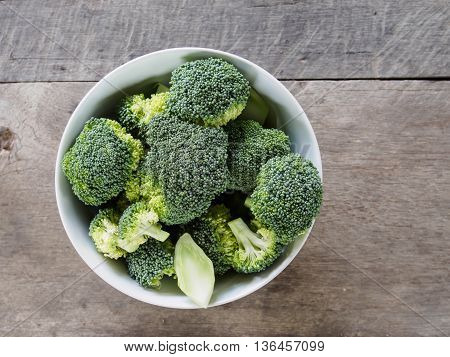 The brocoli on white blow background of wooden background.