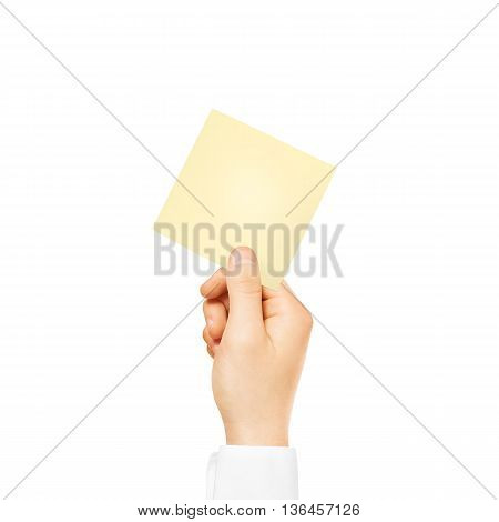 Hand holding square blank yellow sticker mock up isolated. Sticker mockup holder. Empty paper clue remnder hold in hands.