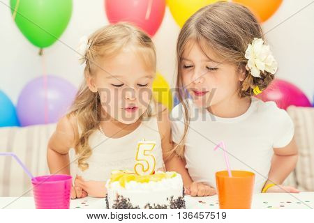 Two little girls at birthday party