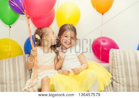 Two girls talking at birthday party