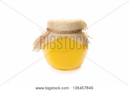 Honey glass jar isolated. Transparent glassy can with natural fresh homemade honey. Honeycomb bank without label.