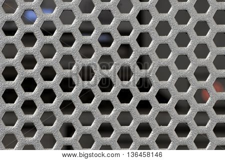 Black round punched mesh of highend server cover with blurry computer server module after lid