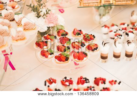 Buffet with a variety of delicious sweets, food ideas, celebration.