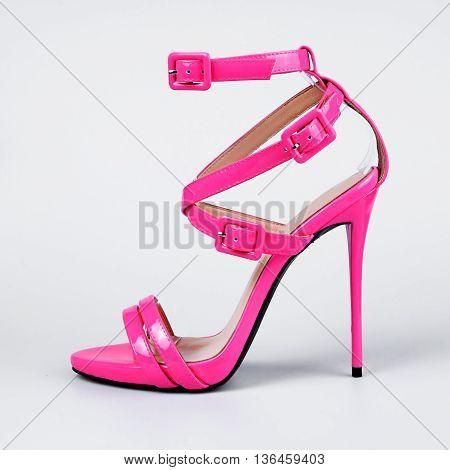 pair of pink women's heel shoes over grey