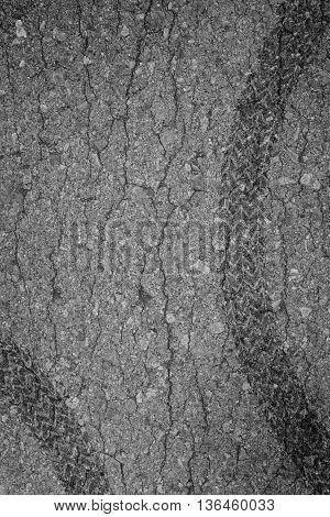 Wheel track asphalt broken of background tex