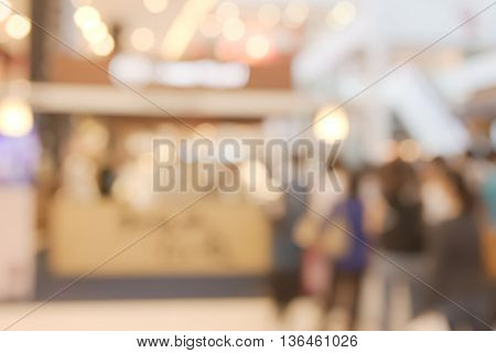 Abstract blurry dessert shop with crowded in queue background