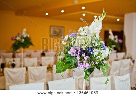 Violet lilac flowers on wedding table at wedding