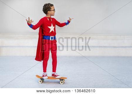 Superman Kid Playing Skateboard Cheerful Concept