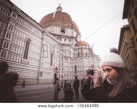 italy florence woman photographing with camera sports