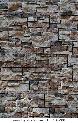 Cladding texture of a stone wall background of natural stone materials