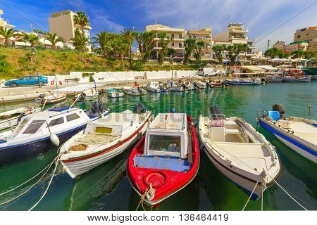 Fishing boat and wharf of Chania in sunny summer day, Crete, Greece