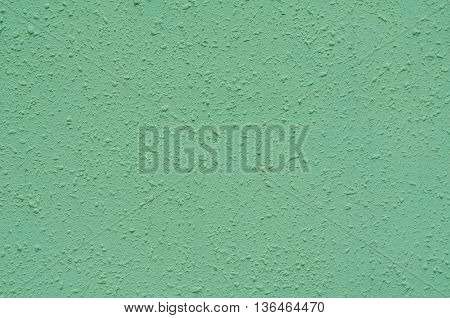 Background of a deep blue stucco coated and painted exterior rough cast of cement and concrete wall texture decorative coating