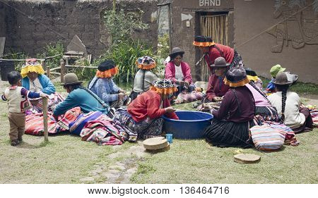 October 22 2012 - Paru Paru Peru: Indigenous women cutting potatoes for a local wedding ceremony.