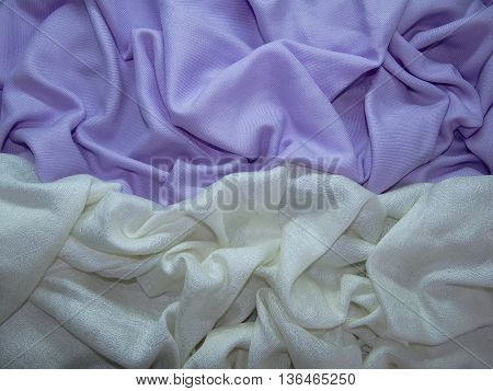 lilac and white fabric is beautiful laid in the crease