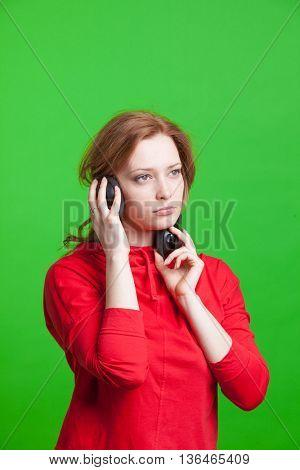 Woman with headphones listening music.
