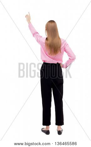 Back view of  pointing woman. beautiful girl. Rear view people collection.  backside view of person.  Isolated over white background. Blonde in black trousers held up a hand up.