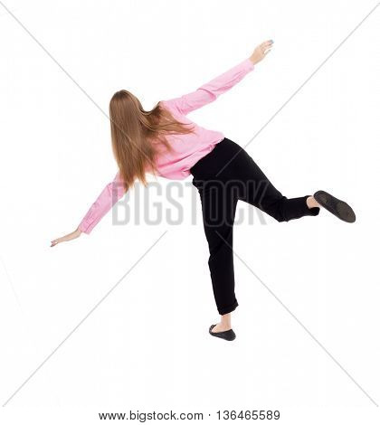 Balancing young business woman.  or dodge falling woman. Rear view people collection.  backside view of person.  Isolated over white background. girl office worker in black trousers trying not to fall