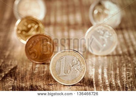 Euro coins. Euro money. Euro currency. Different euro coins on wooden background. Money concept.