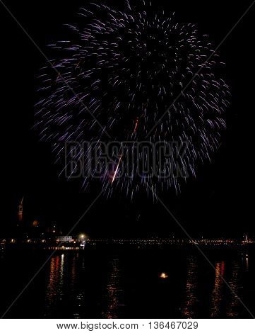 Fireworks light up the sky with dazzling display.Fireworks background. Maltese fireworks. New Year in Venice