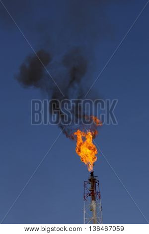 Fossil fuel flame burnoff from associated gases at Oil Power Station