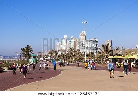 People Enjoy Early Morning Walk On Beach Front