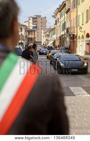 Sant'Agata Bolognese, Italy - April 30, 2016: Mayor of Sant'Agata Bolognese , watching the arrival of the cars in the parade for the 100th Ferruccio Lamborghini Anniversary