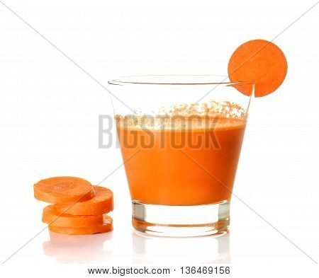 Carrot juice with carrots sliced isolated on white background.