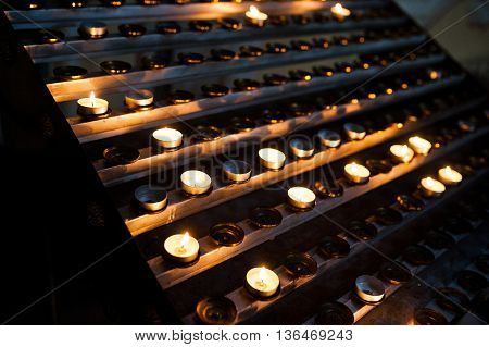 Line Of Round Candles In The Church At Wedding Ceremony