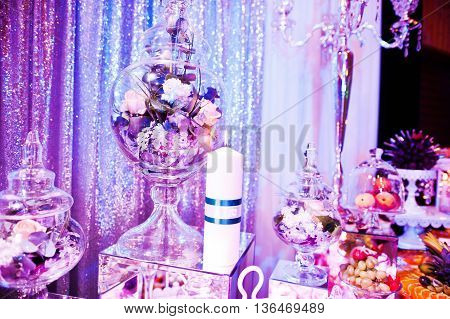 Elegance Wedding Reception Table With Food And Decor. Burning Candle