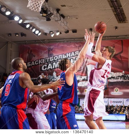 Bc Krasnye Krylia Center Anton Pushkov (14) Shoots Over A Defender