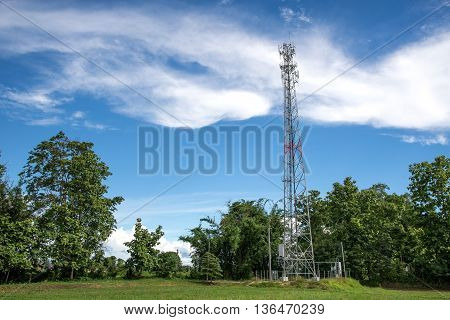 Mobile towers on blue skywhite cloud and tree background.Selection focus.
