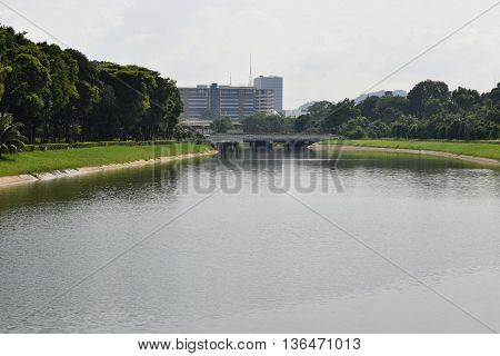 A drainage canal with industrial building as backdrop