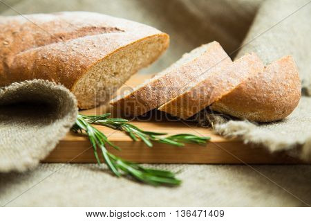 traditional bran homemade bread on a wooden board