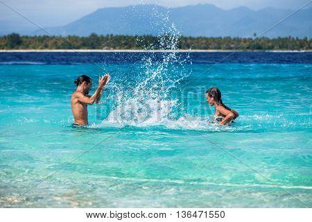 Young couple having fun in a tropical sea