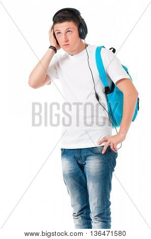 Teen student boy with headphones listening music, isolated over white background
